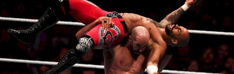 Dishing a body slam to the tag team